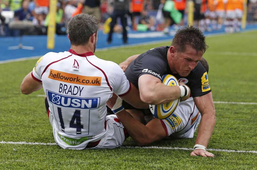 Saracens' Ernst Joubert stretches to dot the ball down