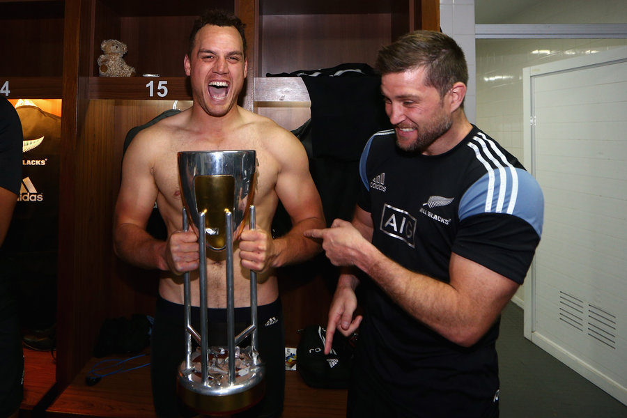 Israel Dagg and Cory Jane of the All Blacks celebrate in the All Blacks changeroom