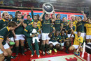 Springboks captain Jean de Villiers raises the Nelson Mandela Challenge Trophy after their victory over the Wallabies
