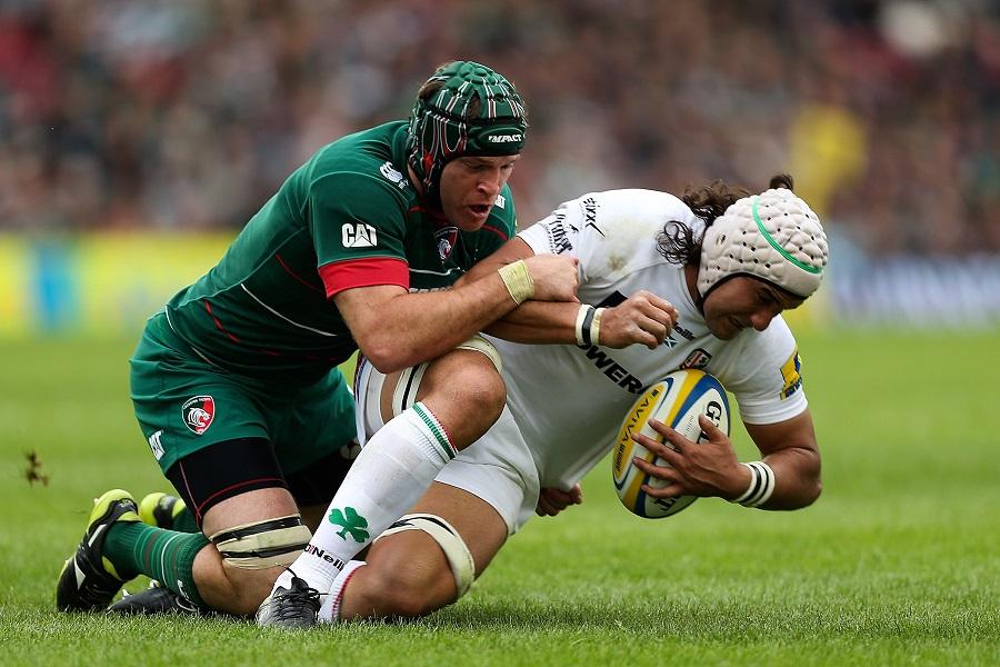 Blair Cowan is tackled by Julian Salvi