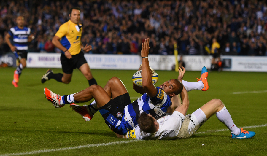 Jonathan Joseph goes over for the first try despite the attentions of Chris Ashton