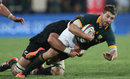 Willie le Roux of South Africa is tackled by Sam Whitelock