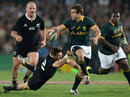 Cobus Reich of South Africa breaks through the All Blacks defence