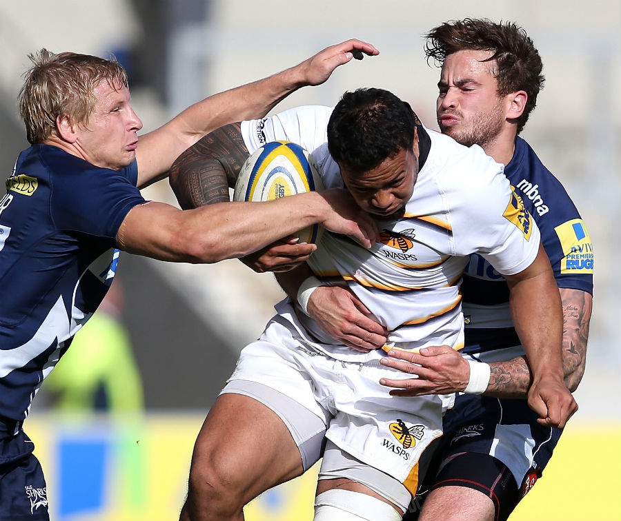 Wasps' Alapati Leiua is tackled by Danny Cipriani