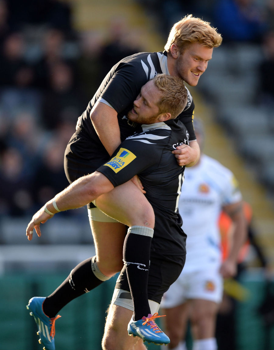 Newcastle's Tom Catterick celebrates his try with Alex Tait