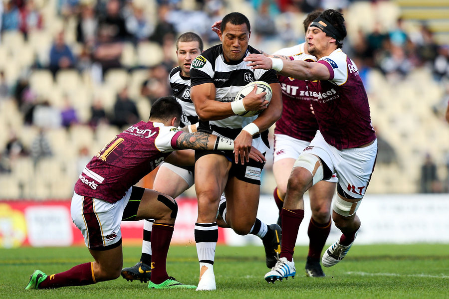 Robbie Fruen of Hawke's Bay is tackled by Elliot Dixon and Keanu Kahukura of Southland