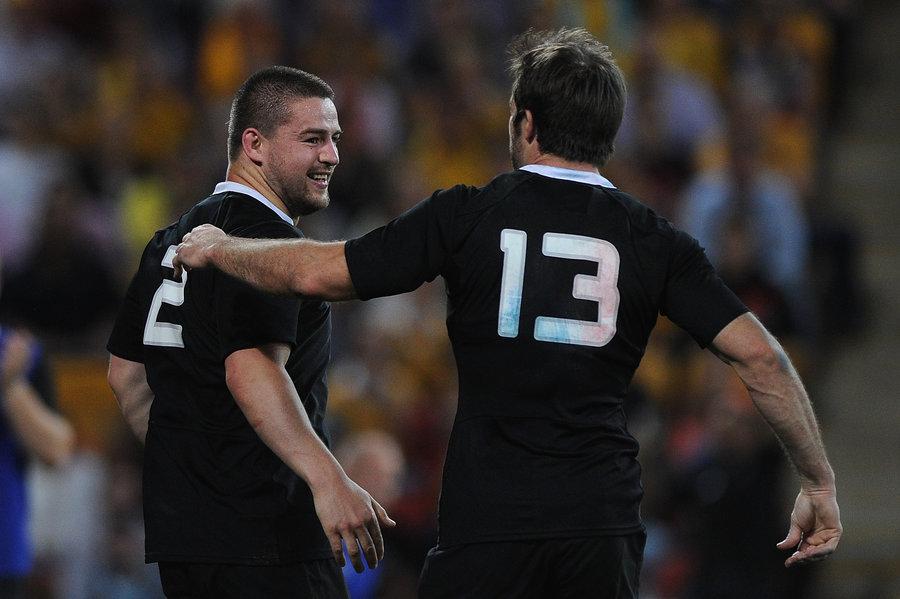 Conrad Smith congratulates Dane Coles for his try