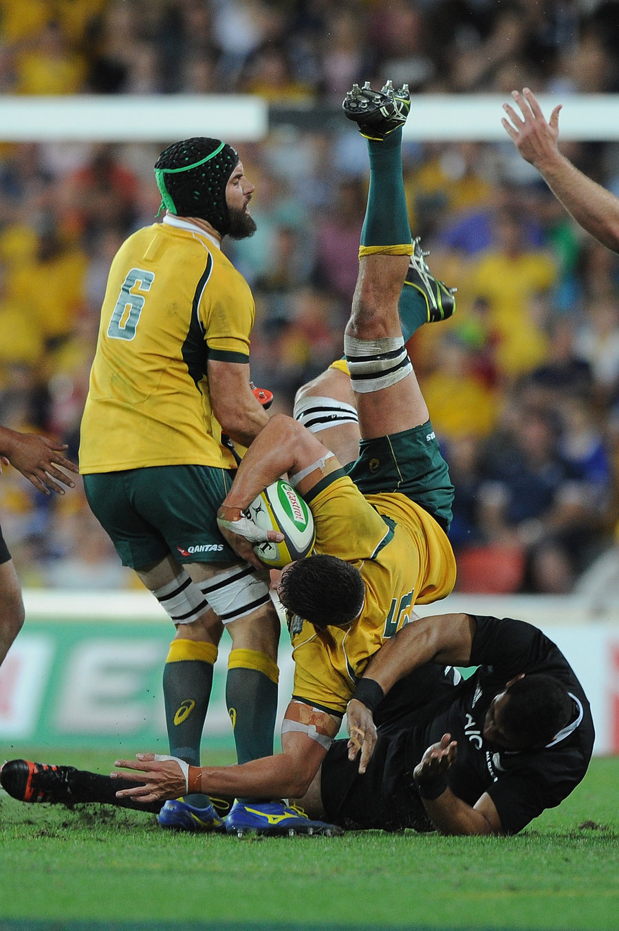 Wallabies' Rob Simmons is taken out in the air by Patrick Tuipulotu