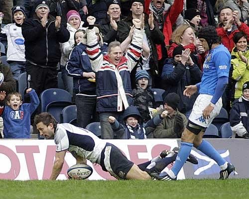 Scotland wing Simon Danielli dives in to score against Italy