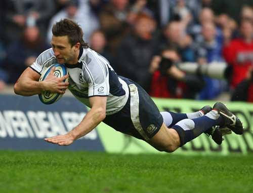 Scotland's Simon Danielli dives over to score a try