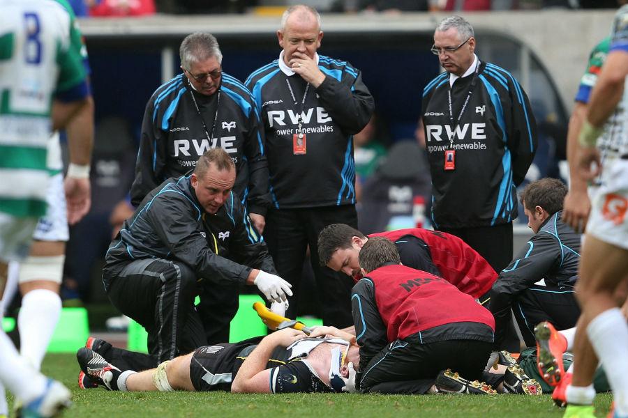 Dan Baker receives treatment following a collision