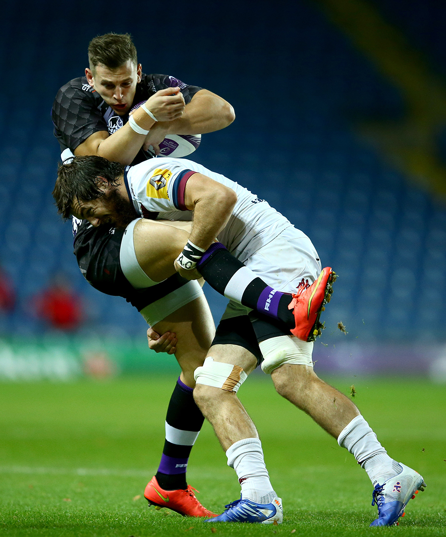 Nick Scott is tackled by Hugh Chalmers