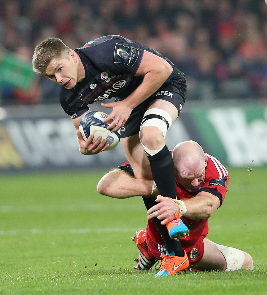 Owen Farrell is tackled by Paul O'Connell