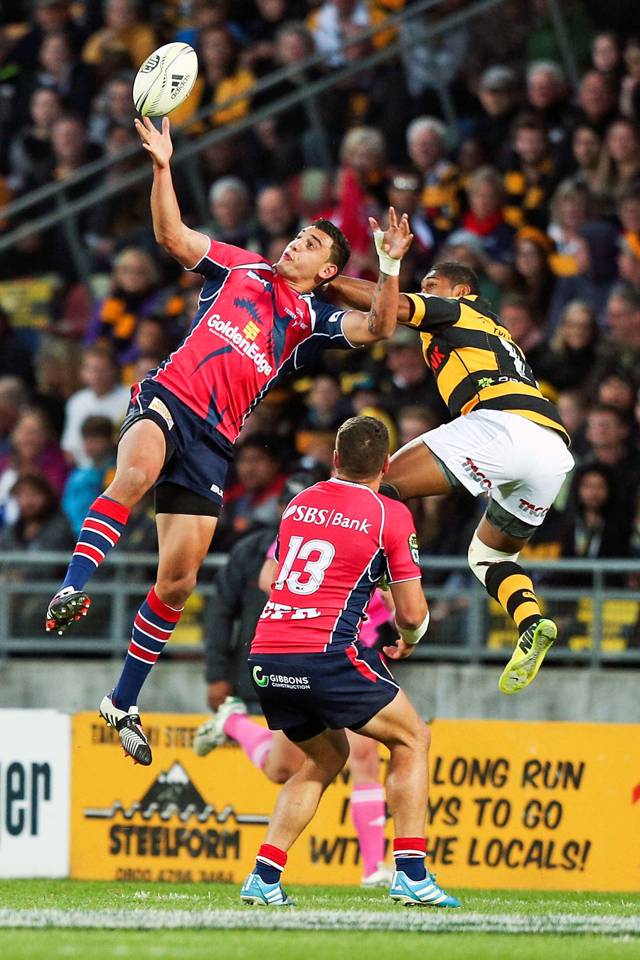 Tasman's Bryce Heem and Taranaki's Waisake Naholo compete for a high ball