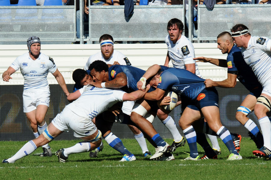Castres and Leinster players battle for the ball