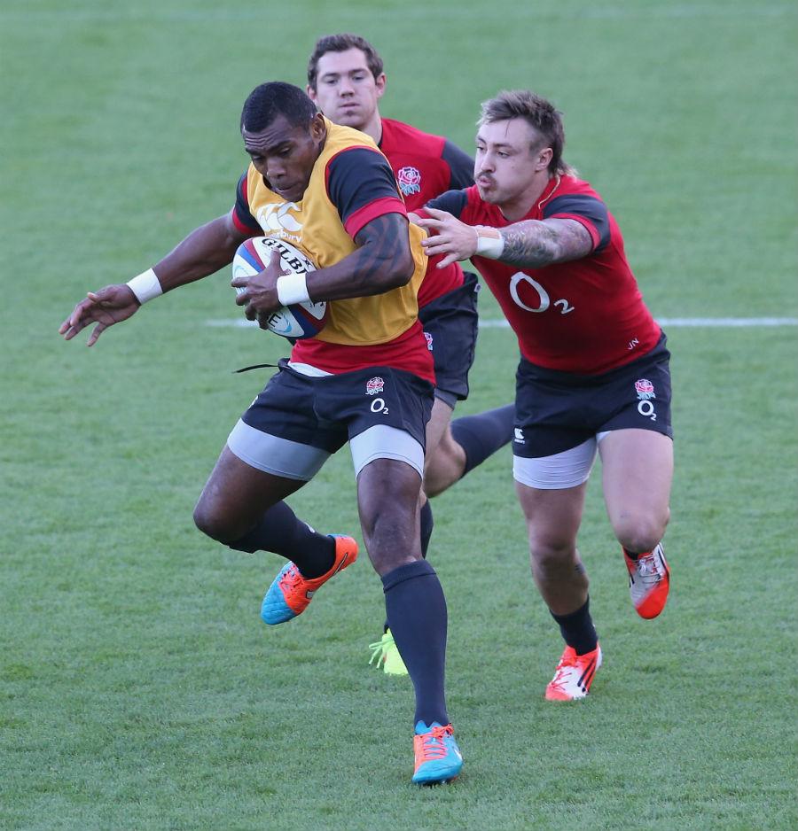 Semesa Rokoduguni evades his team-mates during England training