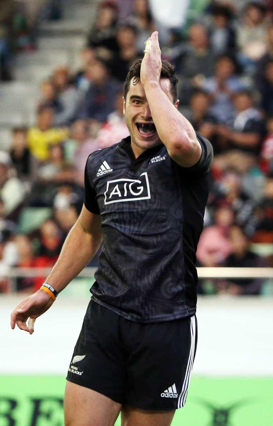 New Zealand Maori All Blacks' James :Lowe celebrates a try