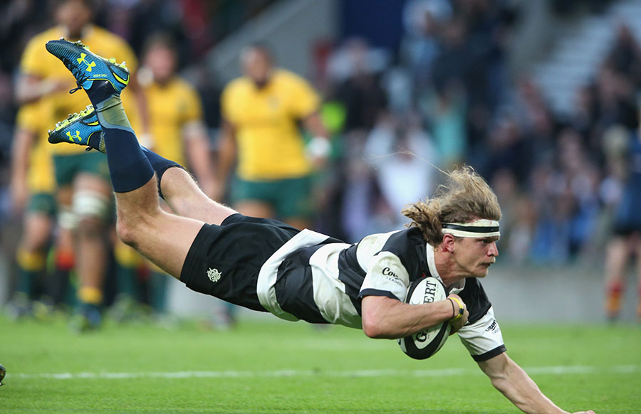 Nick Cummins dives over the line for his try for the Barbarians against his home nation of Australia