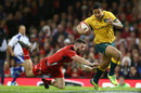Israel Folau escapes Alex Cuthbert's grasp for his first try