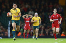 Israel Folau sprints clear for a length-of-the-field intercept try