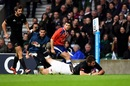 Richie McCaw dives over to score for New Zealand