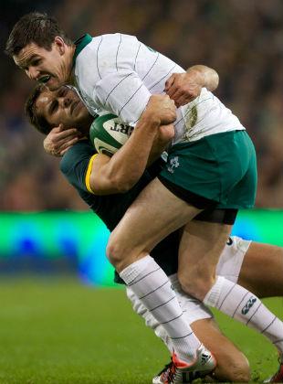 Jonathan Sexton is tackled by Jan Serfontein, Ireland v South Africa, Aviva Stadium, Dublin, November 8, 2014