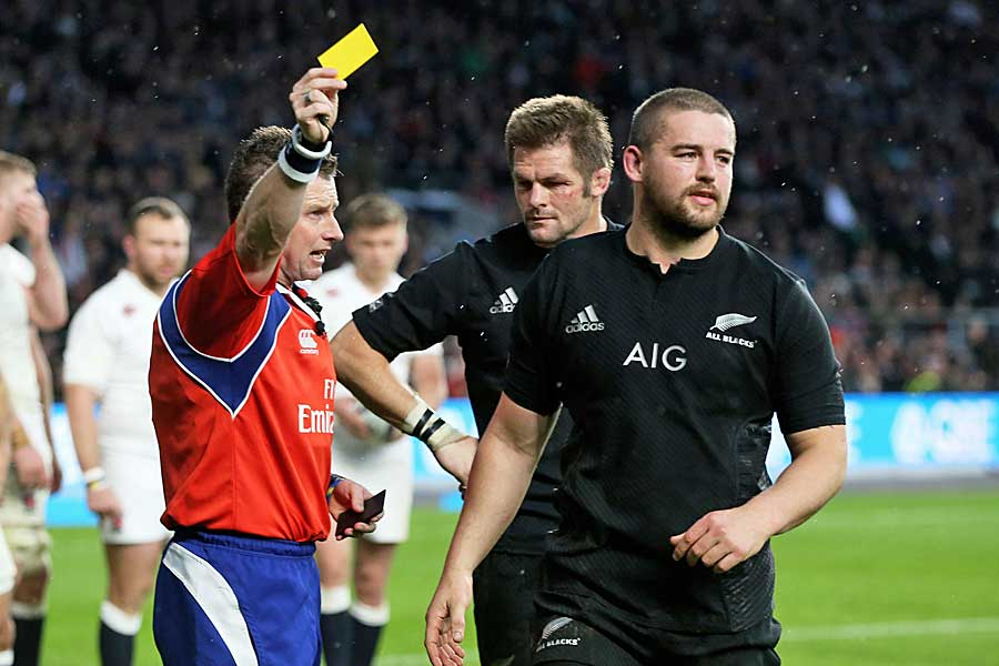 Nigel Owens of Wales issues a yellow card to New Zealand's Dane Coles