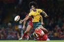 Australia's Joe Tomane gets an offload away against Wales
