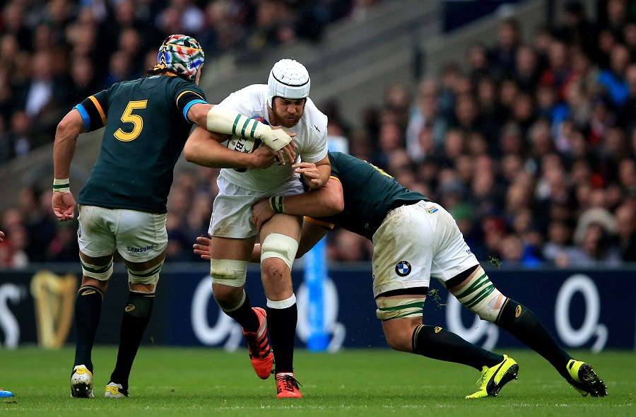 Dave Attwood is tackled by Victor Matfield and Duane Vermeulen