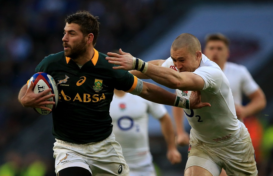 Willie Le Roux fends off Mike Brown