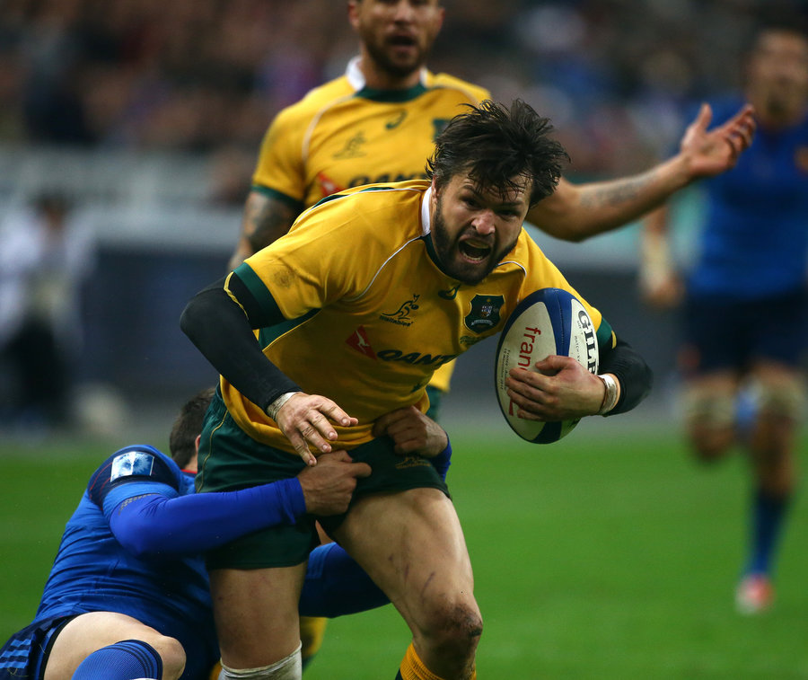 Adam Ashley-Cooper of Australia trys to break through France's Remi Tales tackle