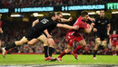 Rhys Webb breaks through to score a try for Wales