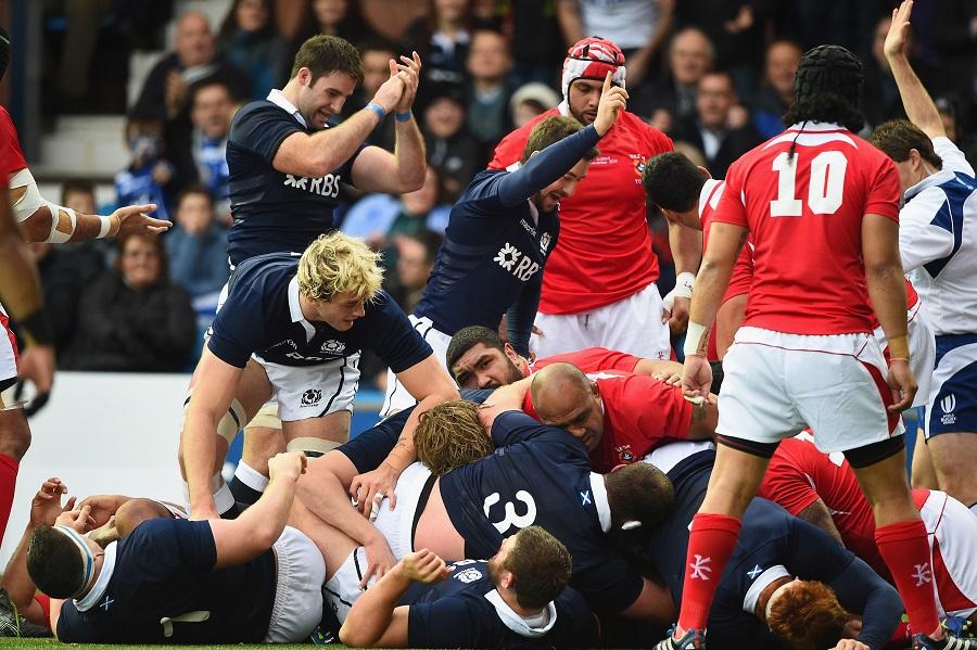 Blair Cowan scores for Scotland against Tonga amid a sea of bodies