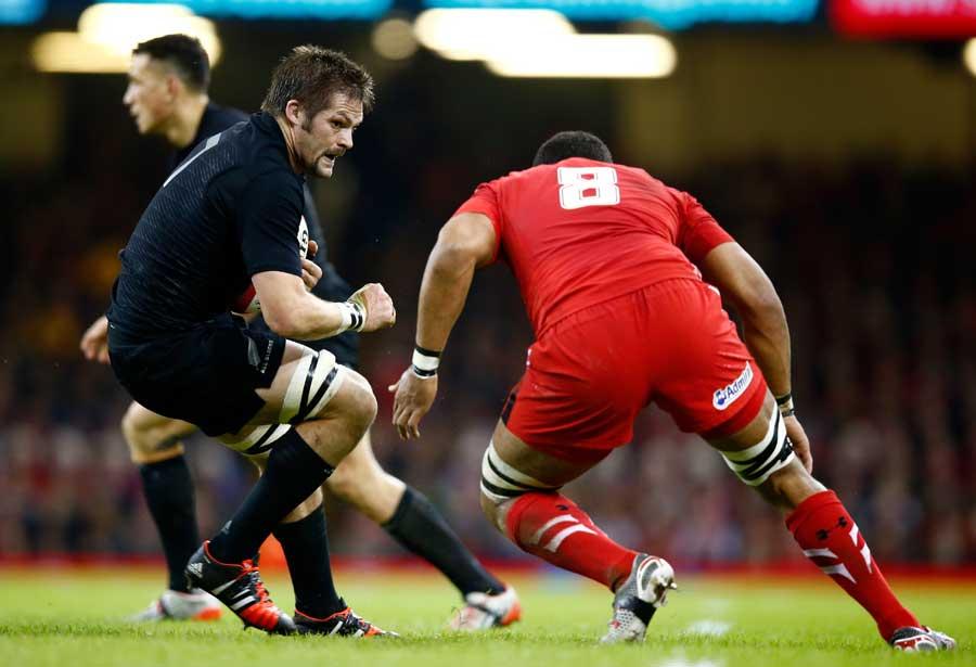 New Zealand's Richie McCaw prepares for the hit from Taulupe Faletau