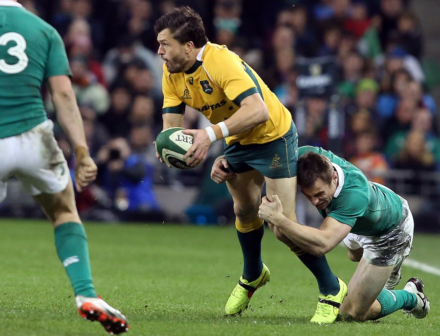 Australia's Adam Ashley-Cooper tries to escape the clutches of Ireland's Tommy Bowe