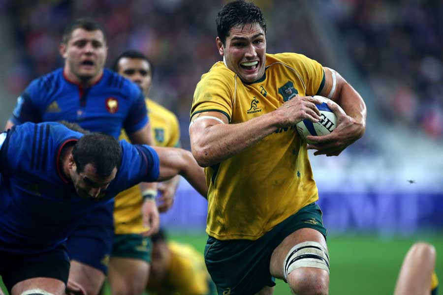 Australia's Rob Simmons breaks away to score a try