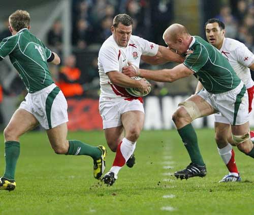 England hooker Lee Mears fends off Ireland lock Paul O'Connell