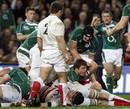 Ireland centre Brian O'Driscoll burrows his way over to score