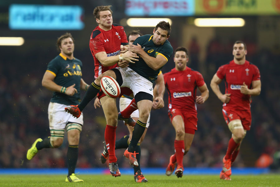 Dan Biggar (left) challenges for a high ball with Cobus Reinach