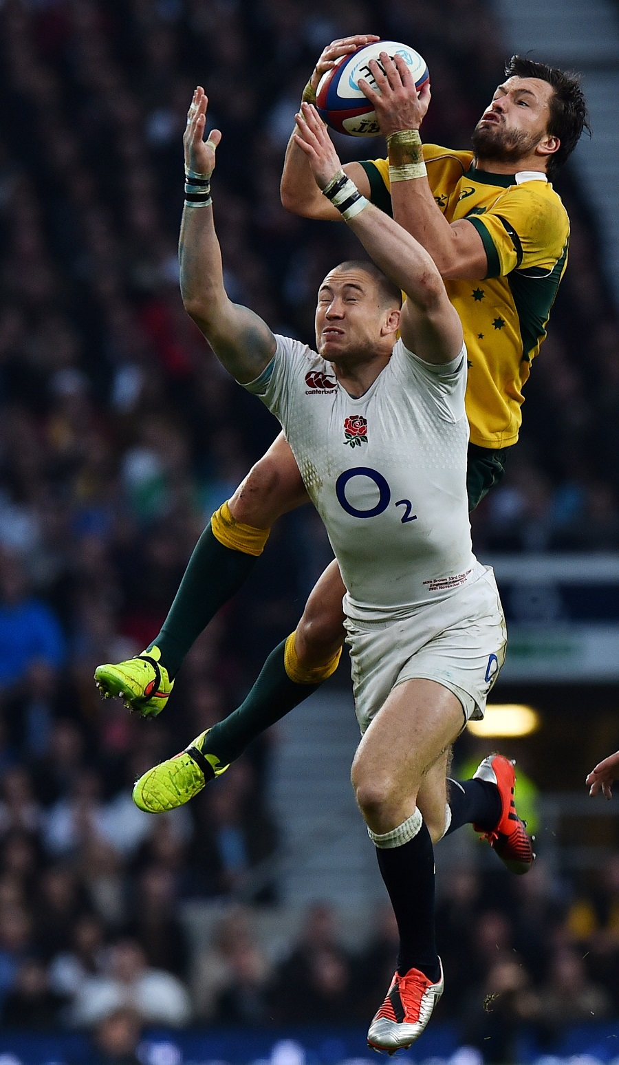 Adam Ashley-Cooper wins a high ball over Mike Brown
