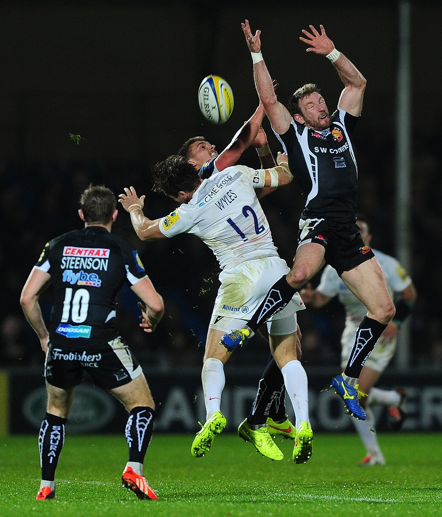 Henry Slade and Matt Jess challenge Chris Wyles for the ball