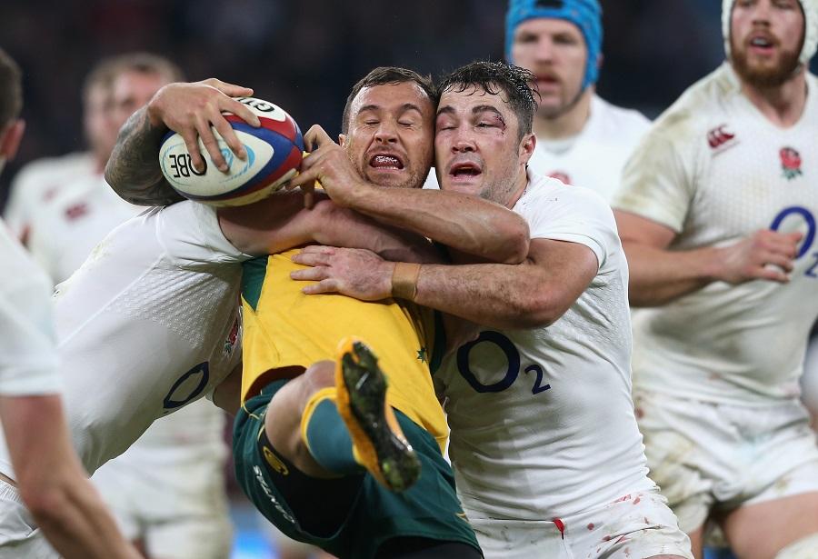 England's Brad Barritt wraps up Quade Cooper of Australia