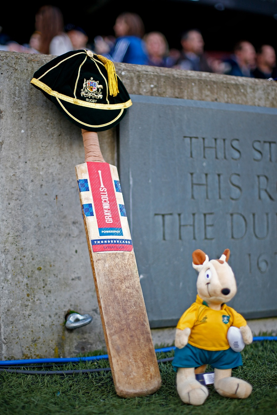 A cricket bat and Australian mascot Wally the Wallaby are placed by the Twickenham pitch in memory of cricketer Phillip Hughes