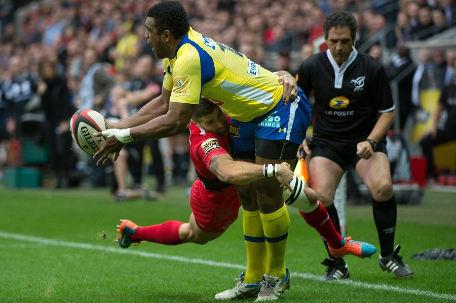 Clermont's Naipoloni Nalaga is hit by a flying tackle from Toulon's Sebastien Tillous-Borde