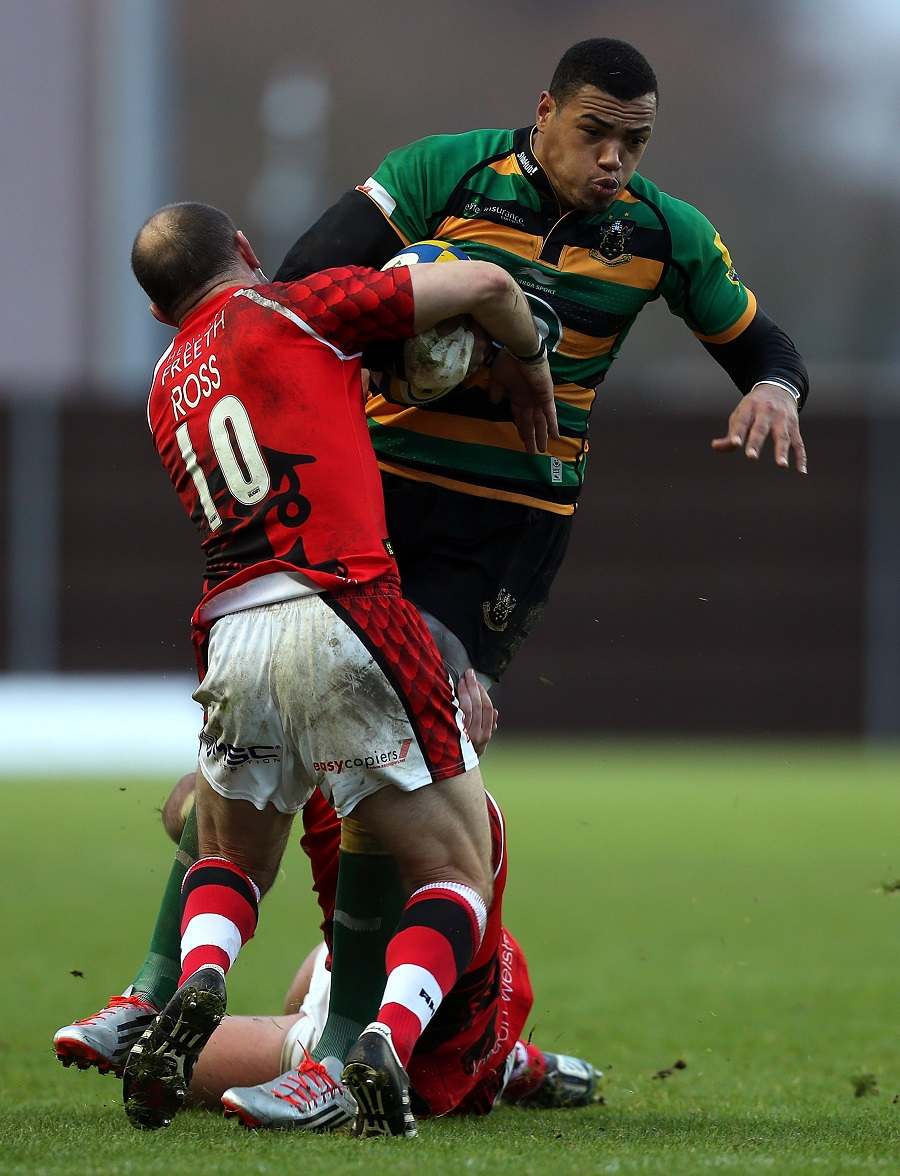 Northampton centre Luther Burrell charges over Gordon Ross of London Welsh