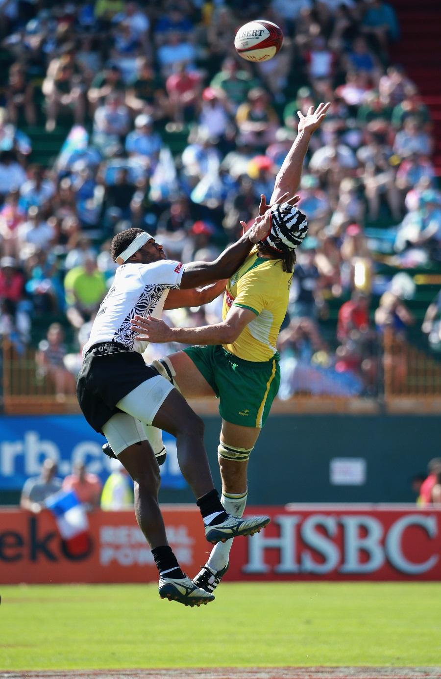 Semi Kunatani of Fiji and Brazil's Juliano Fiori compete for the ball at the Dubai Sevens