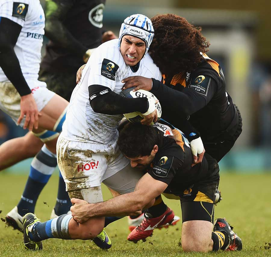 Castres' Daniel Kirkpatrick is wrapped up by Ashley Johnson and Andrea Masi
