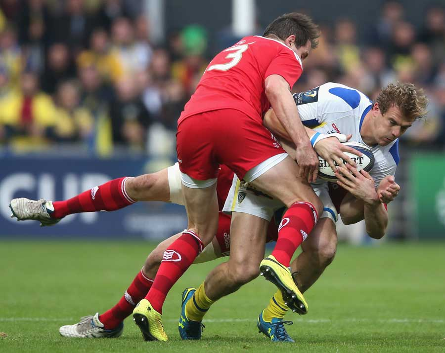 Clermont's Aurelien Rougerie is brought down by the Munster tackler