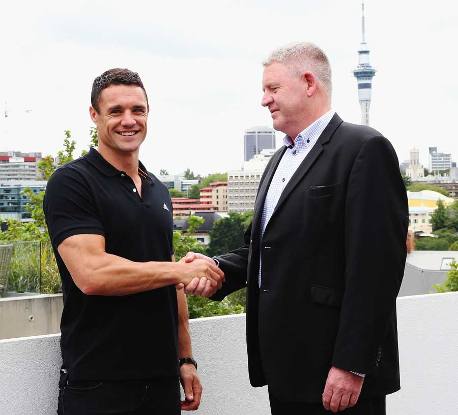 Dan Carter shakes NZRU CEO Steve Tew's hand on the day his move to Racing Metro was confirmed