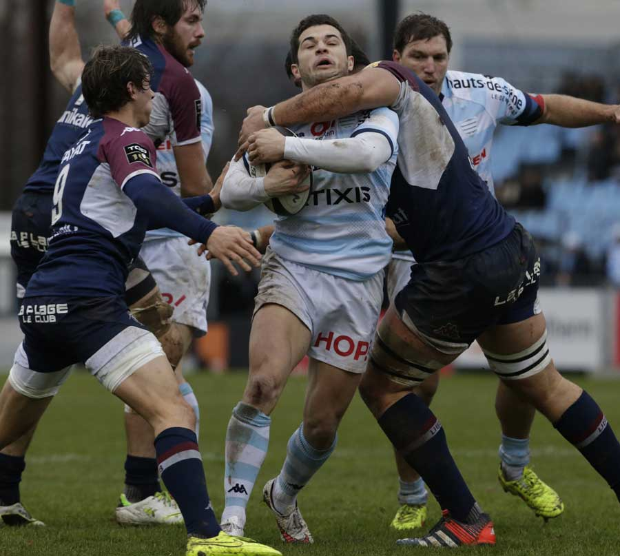 Racing Metro's Brice Dulin is caught by a high shot